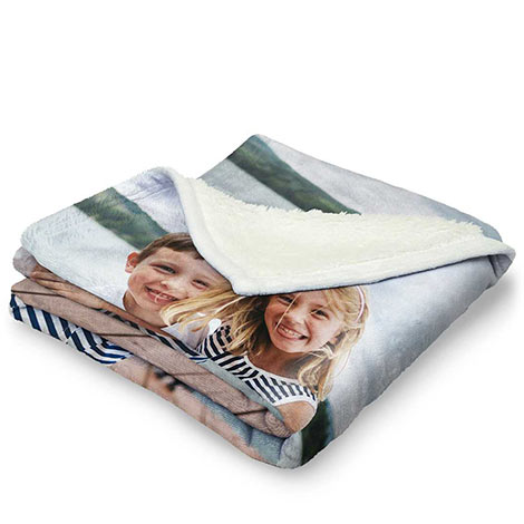 picture of boy and girl on burber fleece blanket