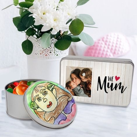 Table with flowers and two personalised gift tins