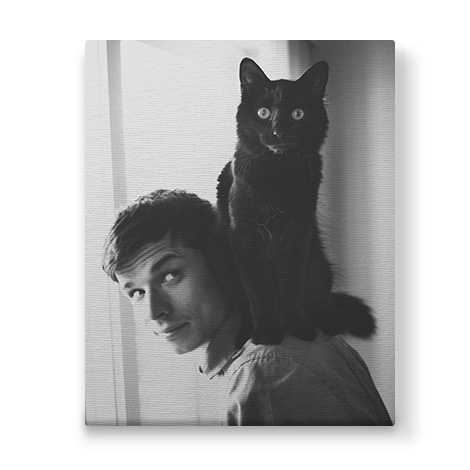 black and white photo with man and a pet cat on his shoulder