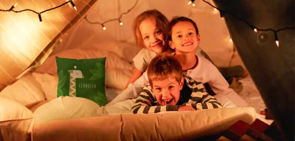 Plan an epic backyard campout with personalized pillows, blankets, and more!
