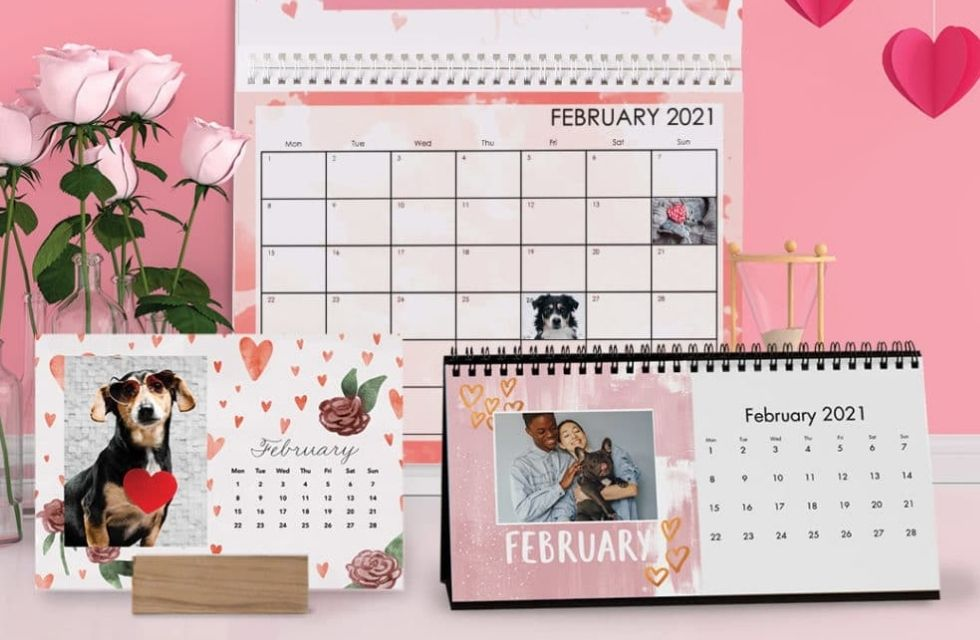 Desk, wall and wood block calendar showing February dates.